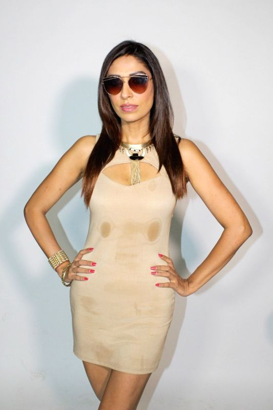 """Model Pooja Mishra during an interview for upcoming music video """"Hotter Than You""""  in Mumbai on May 5, 2017. - Pooja Mishra"""