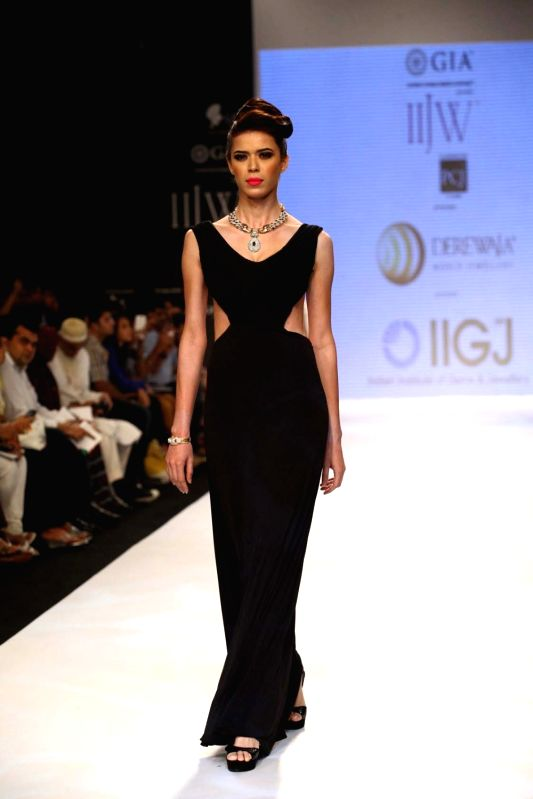Model walks the ramp displaying jewellery during the Derewala IIGJ show at the India International Jewellery Week (IIJW) in Mumbai on August 5, 2013.