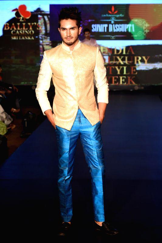 Model walks the ramp for sumit Dasgupta during the lndia`s first Men`s Fashion Week - ILSW, in Bengaluru on 16 Aug 2015.