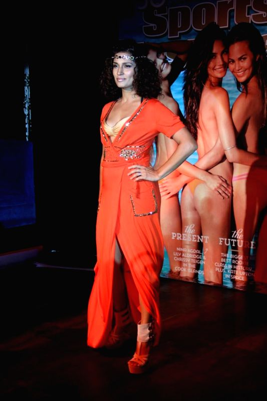 Models at Sports Illustrated India - Swimsuit Issue 2014 launch in association with Kamasutra at Club Royalty showcasing Ambika Sanjana`s BiKa Swimwear Spring/Summer 2015 Collection, in Mumbai on ...