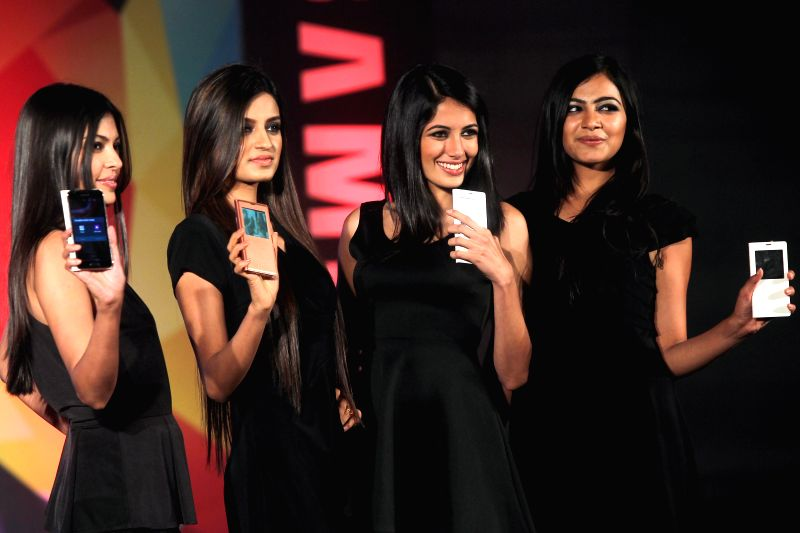 Models at the launch of a Samsung Smartphone in Bangalore on April 11, 2014.