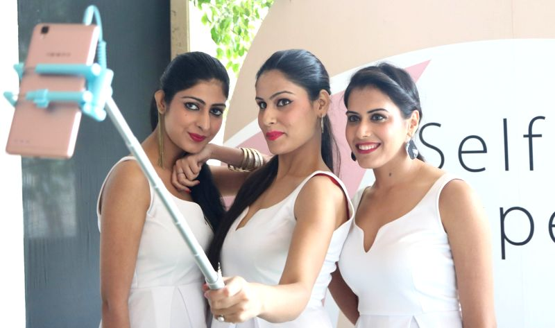 Models at the launch of Oppo F1 Plus phones in New Delhi, on April 5, 2016.