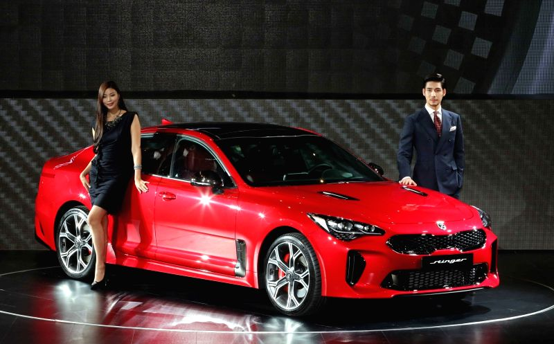 Models display Kia Motors Corp.'s Stinger premium sports sedan at an event at the InterContinental Hotel in southeastern Seoul on May 23, 2017. Kia said it has begun selling the much-awaited ...