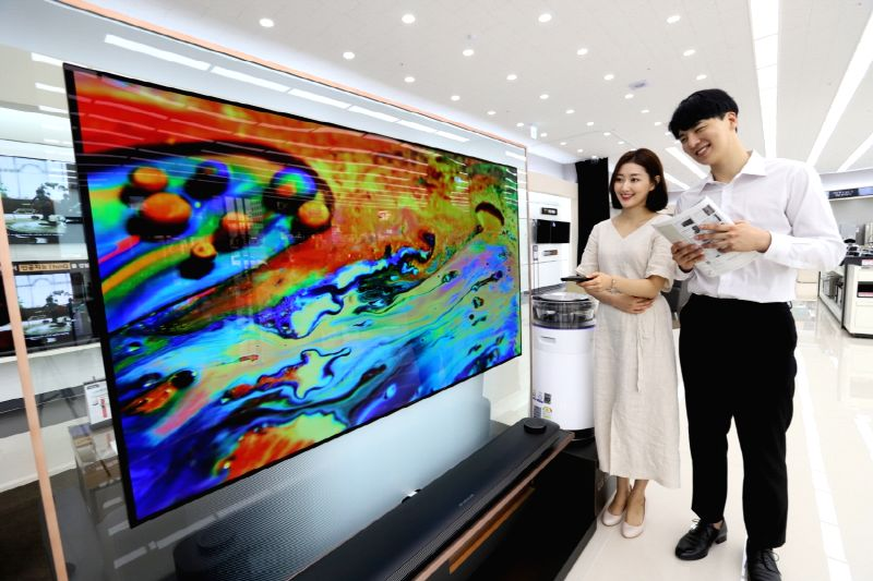 Models display LG Electronics Inc.'s OLED television in this photo provided by the company on Aug. 7, 2018. LG said it will hold a discount event for LG OLED televisions until the end of ...