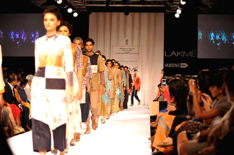 Models display the creation of fashion designer Sayantan Sarkar during the Lakme Fashion Week (LFW) Winter/ Festive 2014 in Mumbai, on Aug. 21, 2014.