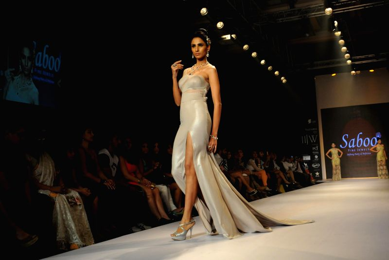 Models displaying Jewellery crafted by Saboo Fine Jewels and in Amy Billimoria`s outfit at the India International Jewellery Week (IIJW) in Mumbai, on July 16, 2014.