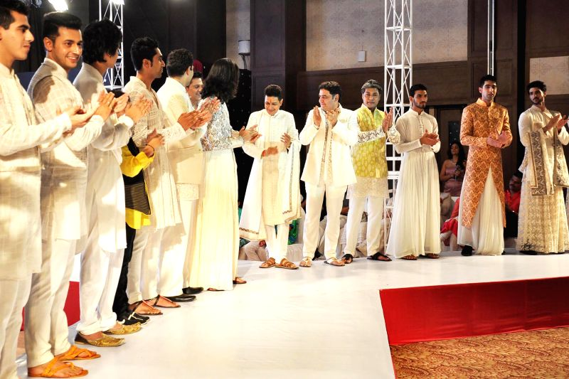 Models during 'Festival of Hope' - a fashion show organised by Indian Cancer Society and DLF in Gurgaon on May 18, 2014.