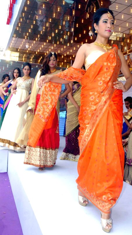 Models during inauguration of a jewellery showroom in Bangalore on June 29, 2014.