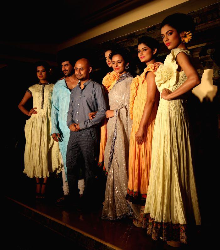 Models during launch of designer Arnab Sengupta's latest Spring-Summer Collection in Kolkata on April 28, 2014.