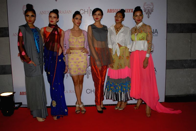 Models during the Absolut Elix and Anushka Ranjan fashion preview in Mumbai, on July 31, 2014.