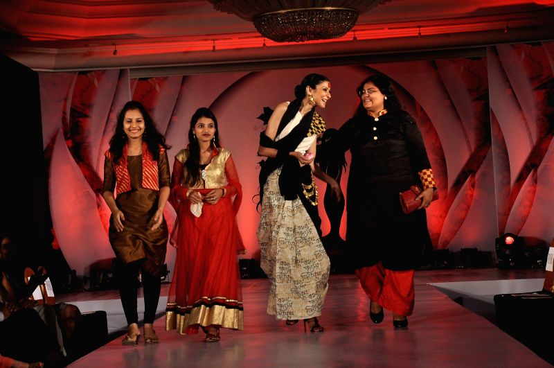 Models during the Chrysalis fashion show in Mumbai, on April 25, 2014.
