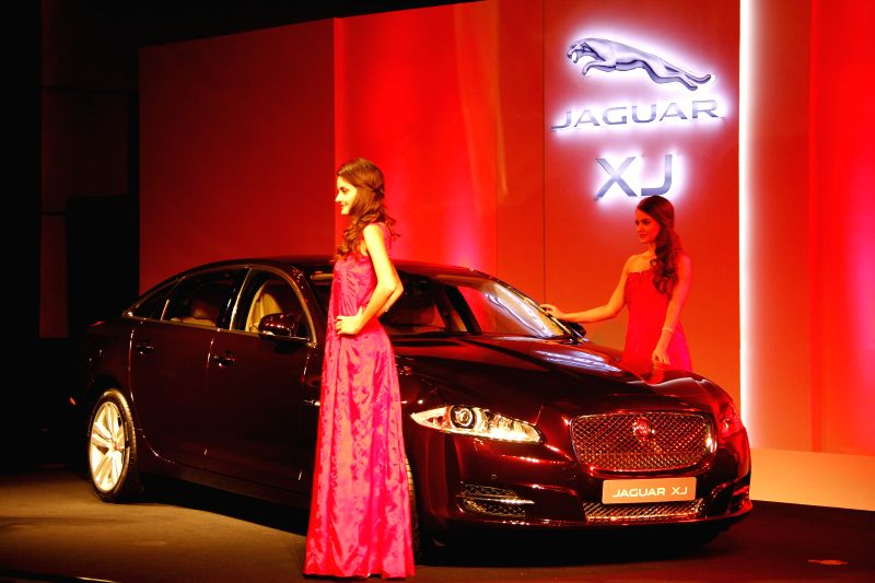 Models during the launch of Jaguar XJ car in Pune on July 5, 2014.