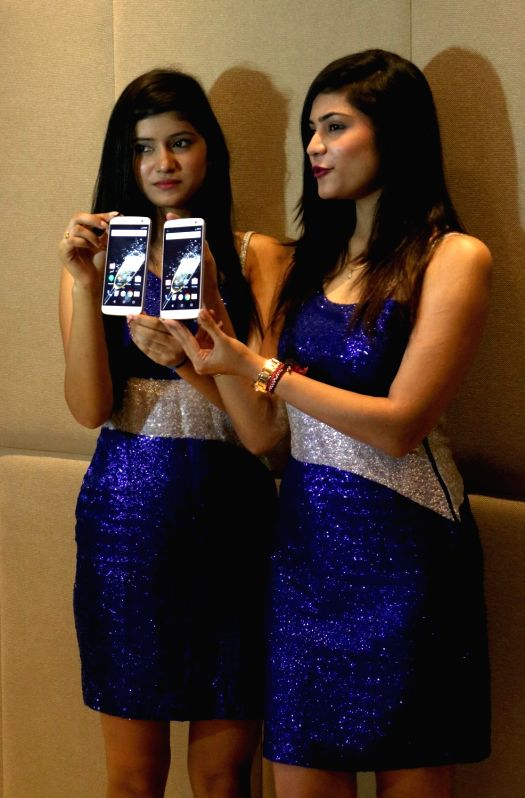 Models during the launch of Zopo mobile's smartphone 'Speed 8' in New Delhi on July 20, 2016.
