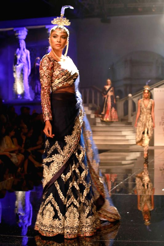 Models performing during fashion designer Suneet Verma`s Show at the BMW India Bridal Fashion Week in New Delhi on Aug 11, 2015.