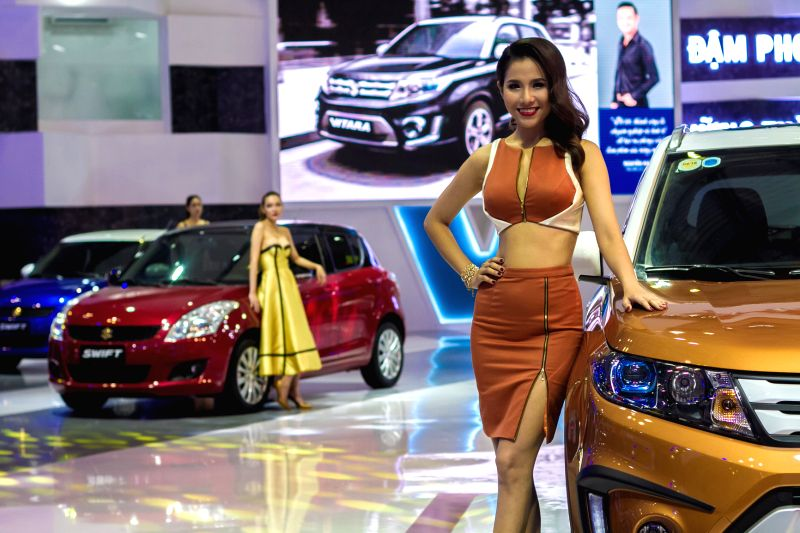Models pose beside cars at the Vietnam Motor Show 2015 in Ho Chi Minh city, Vietnam, Oct. 28, 2015. Vietnam Motor Show 2015, the biggest annual event of ...