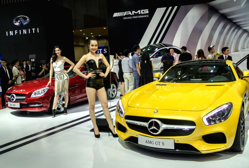 Models pose beside cars during the Vietnam Motor Show 2015 at Saigon Exhibition and Convention Centre in Ho Chi Minh city, Vietnam, Oct. 28, 2015. Vietnam ...