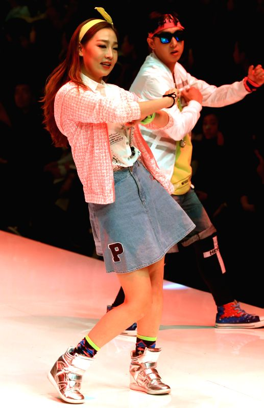 Models present creations at the JeansWest Cup China Casual Wear Design Contest during the China Fashion Week in Beijing, capital of China, Oct. 27, 2015. (Xinhua/Li ...