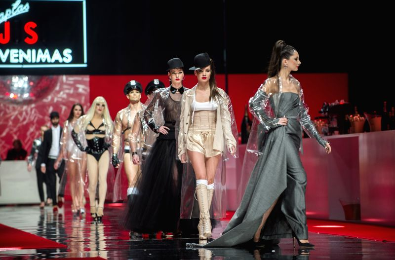 Models present creations by Lithuanian designer Juozas Statkevicius during the 2016 Spring/Summer Collection fashion show in Vilnius, Lithuania, on Dec. 2, 2015. ...