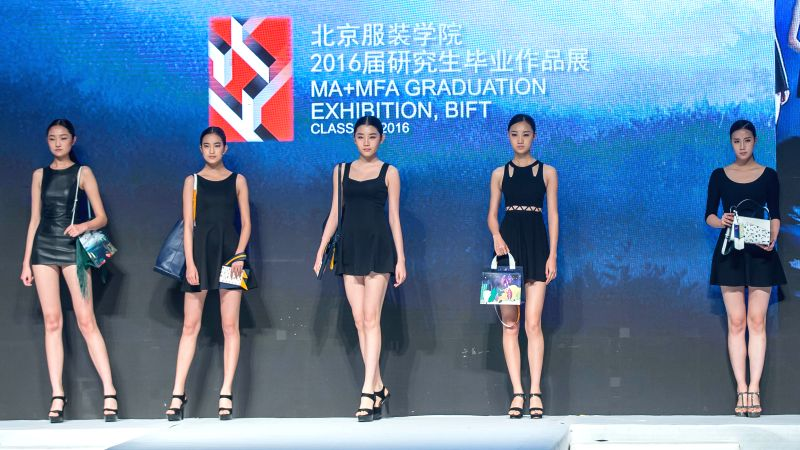 Models present creations designed by graduates of Beijing Institute of Fashion Technology at a fashion show in Beijing, capital of China, Dec. 1, 2015. (Xinhua/Li ...