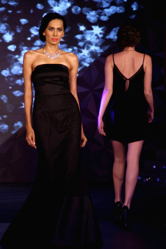 Models showcase a new range of jewellery during a fashion show in New Delhi on July 3, 2014.