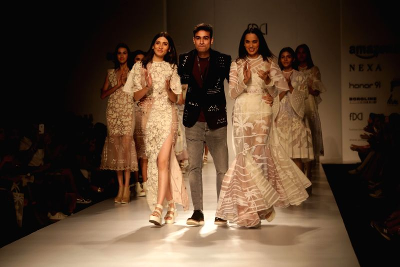 Models showcase creations of fashion designer Sahil Kochhar at Amazon India Fashion Week Summer Spring in New Delhi, on Oct 12, 2017.