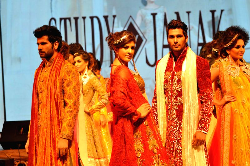 Models showcase designer Vandy Mehra's creations during a fashion show in Gurgaon on May 14,2014.