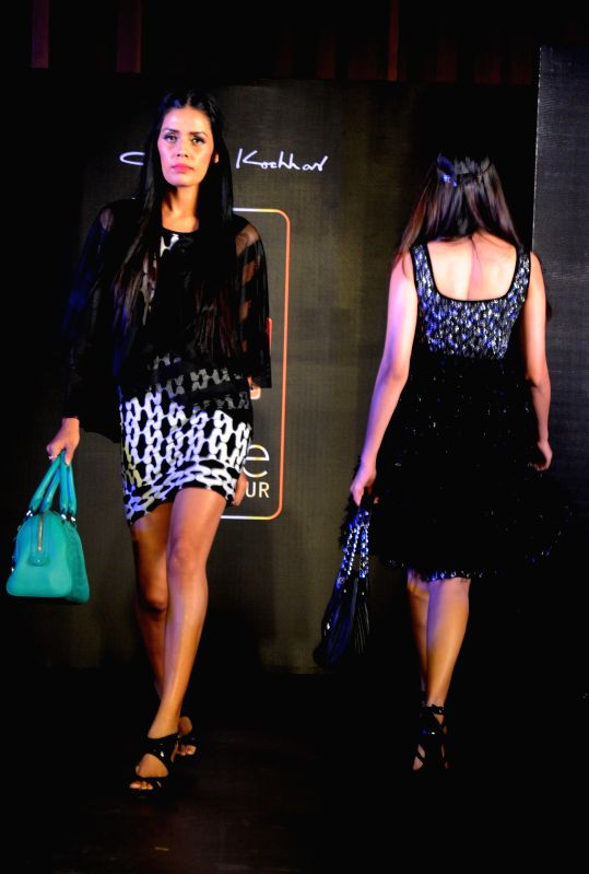 Models showcase fashion designer Jattinn Kochhar and Sheetal Lyall's creation during Kingfisher Ultra Punjab Style Tour in Amritsar on Aug 2, 2014.