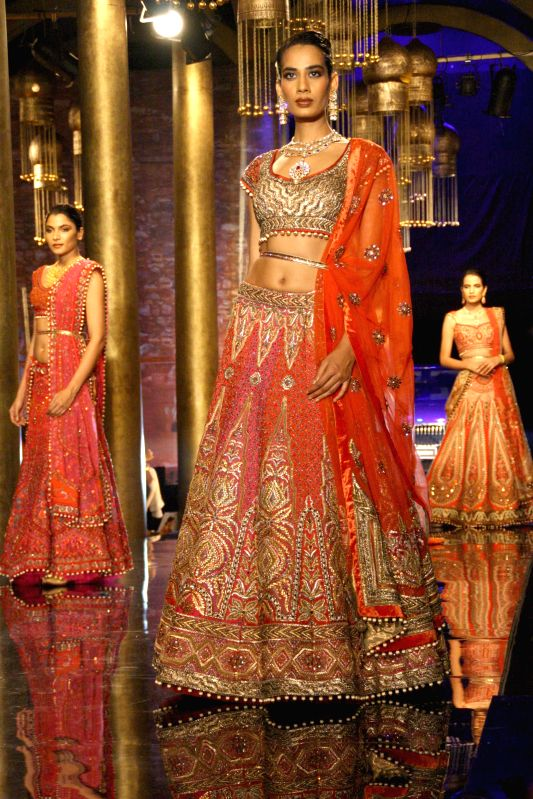 Models showcase fashion designer JJ Valaya's creations during `BMW India Bridal Fashion Week 2014` in New Delhi on Aug 10, 2014.