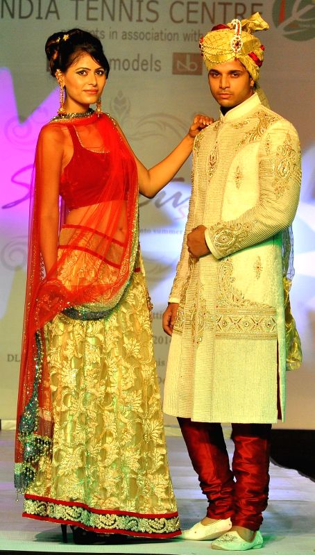 Models showcase fashion designer Manish Sharma's creations at Signature Style Fashion Voyage in New Delhi on Aug 9, 2014.