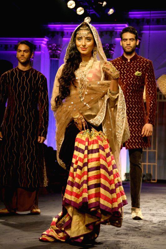 Models showcase fashion designer Meera Muzaffar Ali's creations during `BMW India Bridal Fashion Week 2014` in New Delhi on Aug 10, 2014.