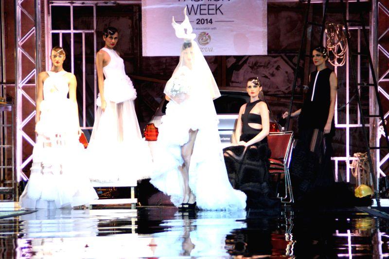 Models showcase fashion designers Gauri and Nainika's creations during  `BMW India Bridal Fashion Week 2014` in New Delhi on Aug 7, 2014.