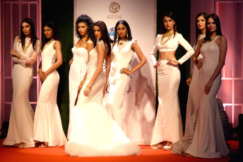 Models showcasing AZVA creations during `BMW India Bridal Fashion Week 2014`, in New Delhi on August 09, 2014.