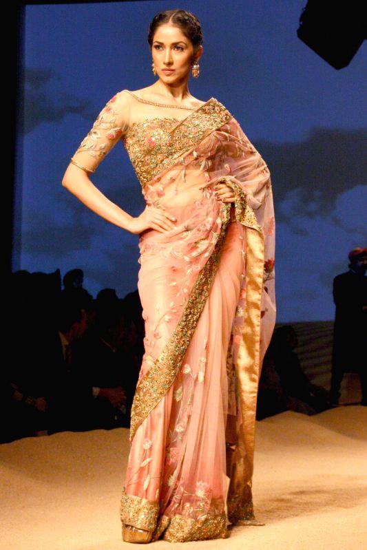 Models showcasing designer Ashima Leena`s creations during `BMW India Bridal Fashion Week 2014`, in New Delhi on Aug. 8,2014.
