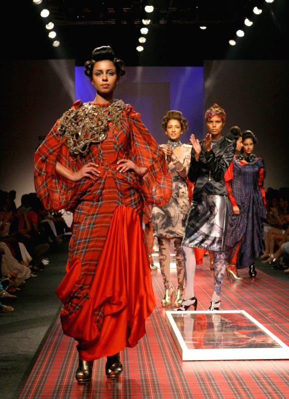 Models showcasing designer Gaurav Gupta's creations at the Wills Lifestyle India Fashion Week 2010, in New Delhi on Thrusday.