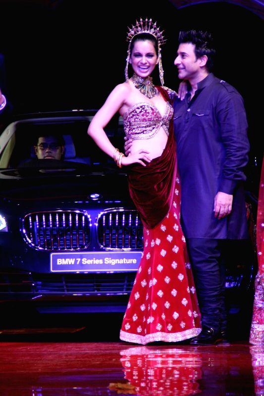 Models showcasing designer Suneet Verma's creation during `BMW India Bridal Fashion Week 2014`, in New Delhi on August 09,2014.