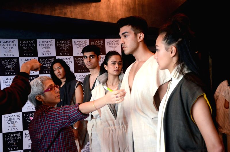 Models take part in fitting session for the upcoming Lakme Fashion Week Summer Resort 2018 in Mumbai on Jan 29, 2018.