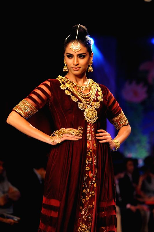 Models walk on the ramp during the grand finale of India International Jewellery Week (IIJW) in Mumbai on July 17, 2014.