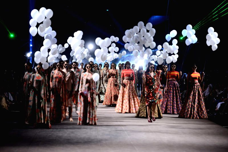 Models walk on the ramp for fashion designer Sabyasachi Mukherjee`s show at the Lakme Fashion Week Summer Resort 2015 in Mumbai on March 17, 2015.