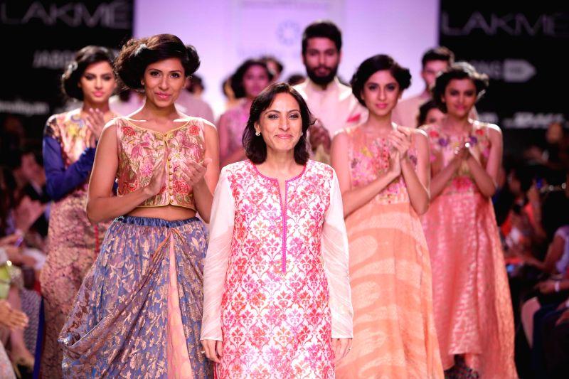 Models walk on the ramp with fashion designer Krishna Mehta during her show at Lakme Fashion Week (LFW) Winter/ Festive 2014 in Mumbai, on Aug. 21, 2014.