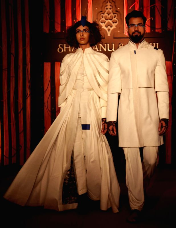 "Models walk the ramp at fashion designer Shantanu-Nikhil's show - ""Independence"" where their Autumn-Winter 2018 couture collection was showcased, in New Delhi on July 21, 2018."