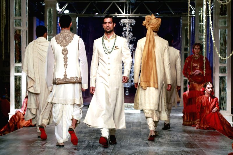 Models walk the ramp displaying an outfit by fashion designer Tarun Tahiliani during the India Couture Week 2016, in New Delhi on July 21, 2016.