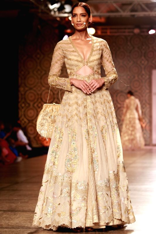 Models walk the ramp displaying an outfit by fashion designers Rimple and Harpreet Narula during the India Couture Week 2016, in New Delhi on July 22, 2016.
