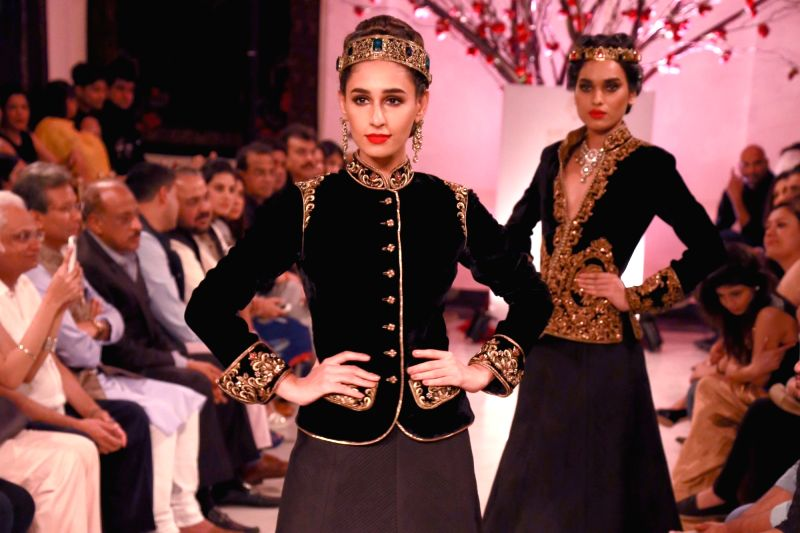 Models walk the ramp displaying an outfit by fashion designer Rohit Bal' during the India Couture Week 2016, in New Delhi on July 24, 2016.