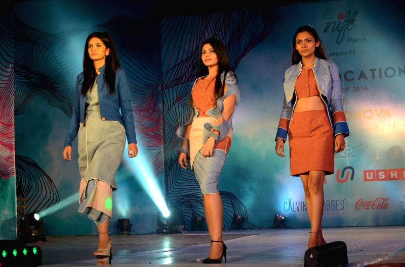 Models walk the ramp during a fashion show organised by NIFT in Patna, on May 19, 2016.