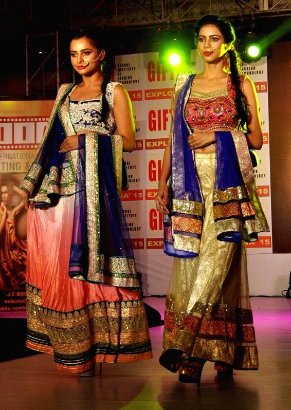 Models walk the ramp during a fashion show in Kolkata, on Dec 11, 2015.