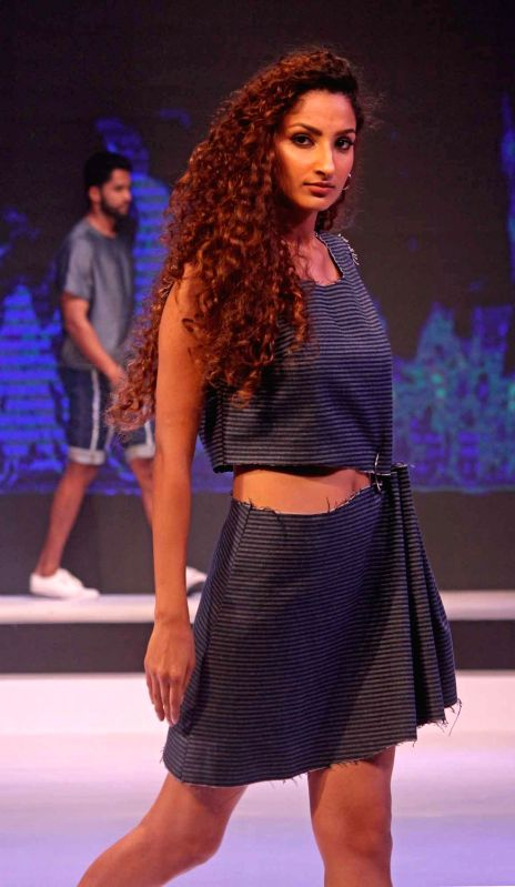 Models walk the ramp during a fashion show in Bengaluru, on May 23, 2017.