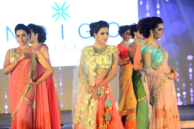 Models walk the ramp during GJF Fashion Nite by All India Gems & Jewellery Trade Federation in Mumbai on Aug 5, 2016.