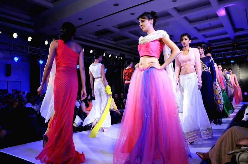 Models walk the ramp during Kingfisher Ultra Style Week Bangalore 2014 in Bangalore on July 26,  2014.