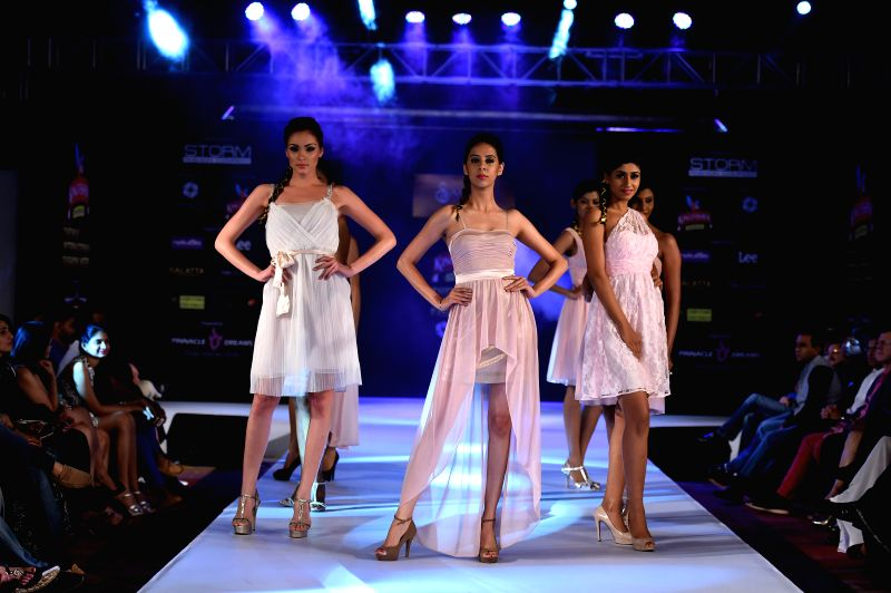 Models walk the ramp during the 6th edition of Kingfisher Premium Chennai International Fashion Week 2014 in Chennai on July 20, 2014.