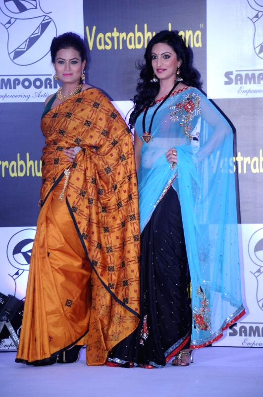Models walk the ramp during `Vastrabhushana - 2014` in Bangalore on July 9, 2014.